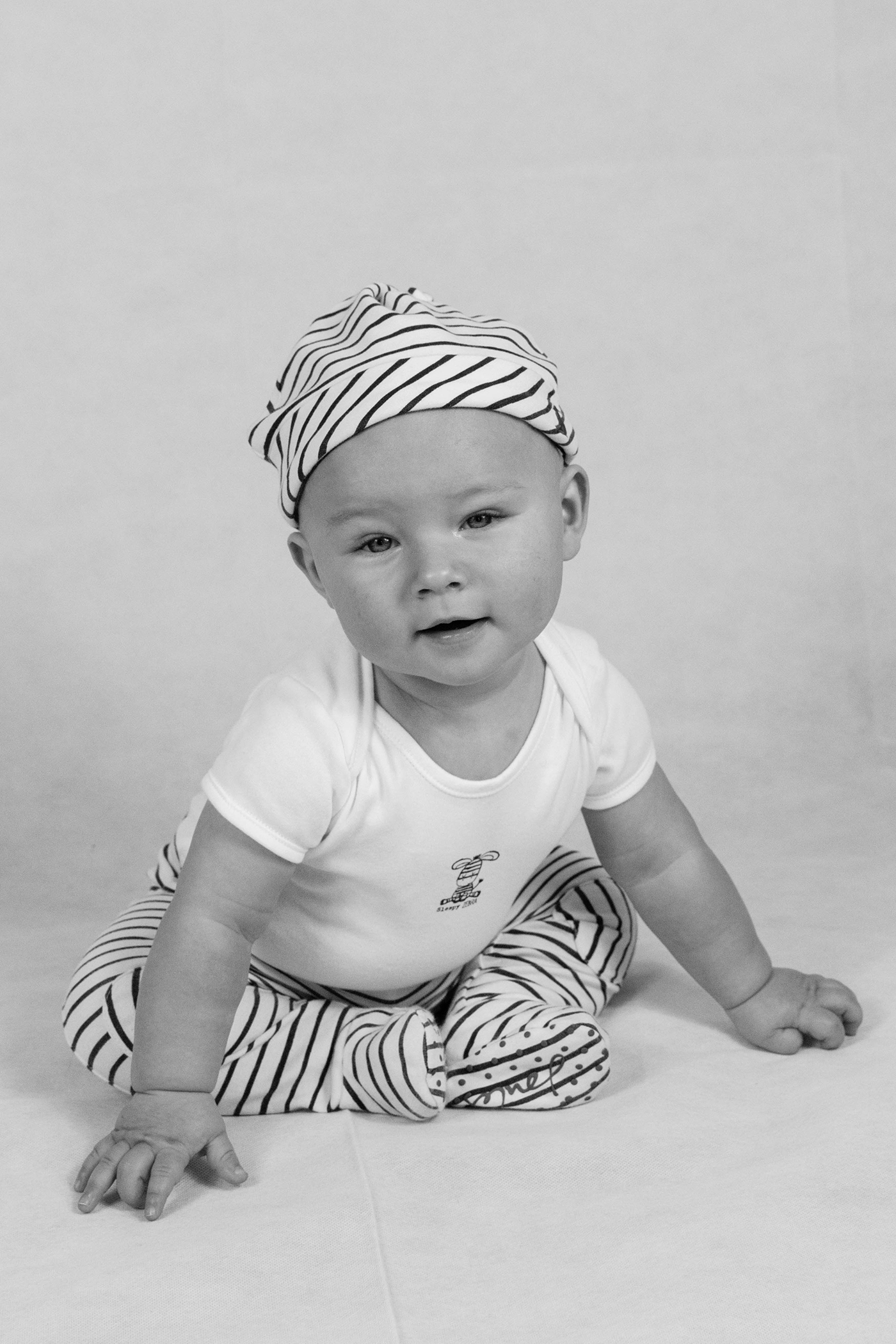 A wonderful little boy, at our on home toddler photography session in black and white finish