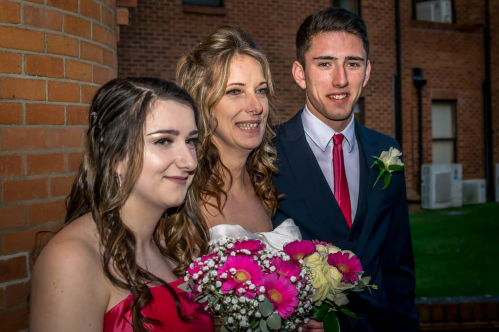 Bride with Honorary Father of the Bride and bridesmaid in Wedding photography East Dereham Registry Office Norfolk