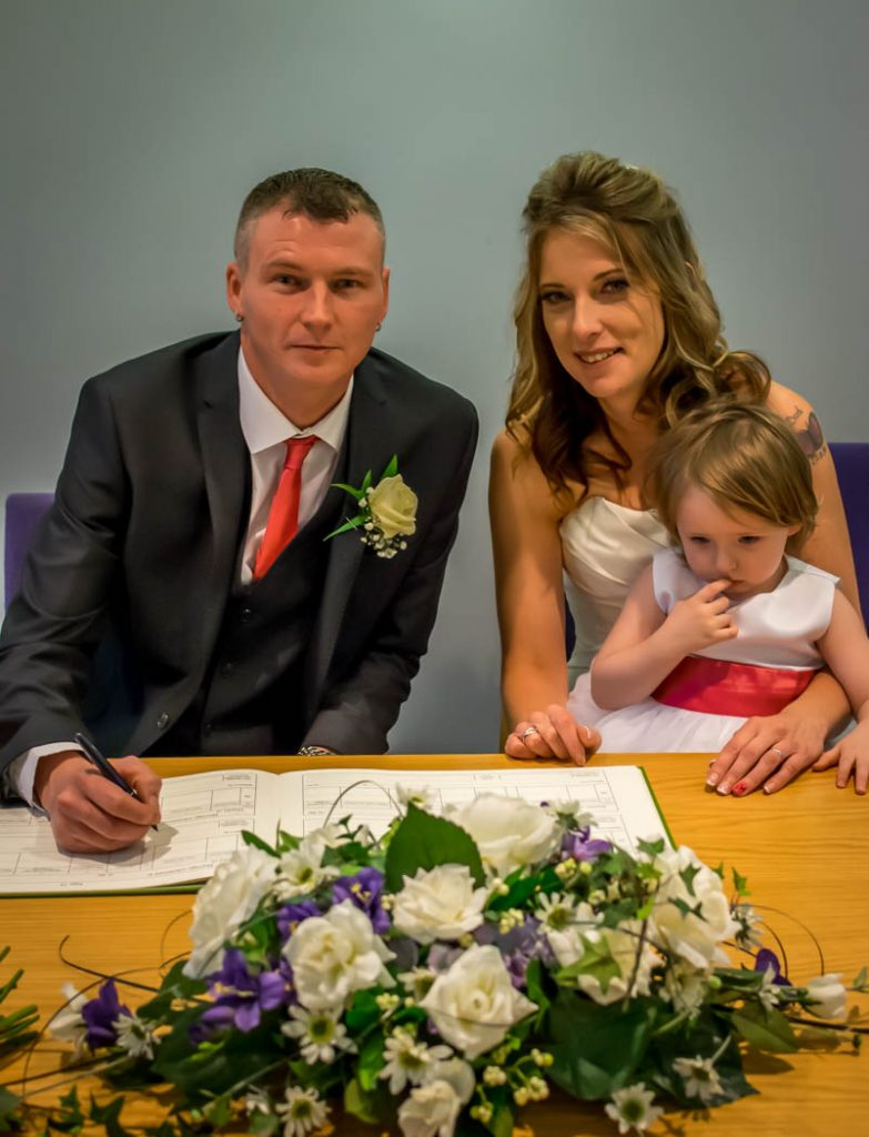 signing of register bride and groom in Wedding photography East Dereham Registry Office Norfolk