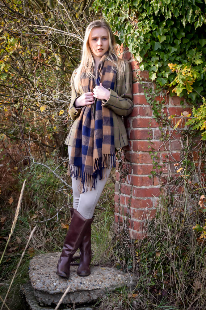 Resting by an old red brick wall for our photography shoot in Suffolk